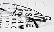 Glasses on eyesight test chart Stock Photos