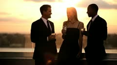 Multi ethnic friends toasting with cocktails and gossiping at roof luxury party  Stock Footage