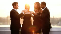 Multi ethnic men and women chilling and drinking   - stock footage