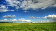 Stock Video Footage of 4K. Timelapse clouds over the green field. FULL HD, 4096x2304.