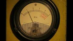 Partly lit geiger counter dial radiation reading 1 Stock Footage