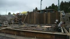 Home construction site, concrete pump unit tilt up reveal Stock Footage