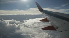 Stock Footage - HD 1080p - Commercial Jet Cruising over Clouds - Audio - stock footage