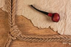 rope and tobacco pipe - stock photo