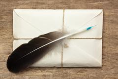letter and a quill - stock photo