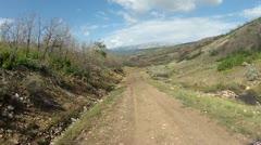 ATV ride along mountain dirt road HD 015 Stock Footage