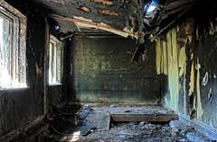 old abandoned burned house inside hdr - stock photo