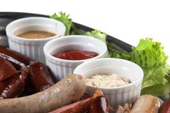 chopped sausages fried with spices - stock photo