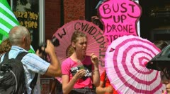 Anti-war protesters hold signs charlotte democratic national convention 2012 Stock Footage