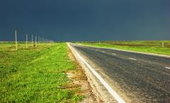 country two lane highway  before the storm - stock photo