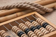Old wooden abacus on the background of bagging Stock Photos