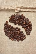 Coffee beans and rope knot on sack Stock Photos