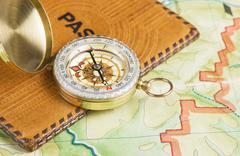 Stock Photo of compass and passport on the map