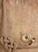 Compass and rope on a wooden background Stock Photos