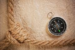 compass with ropes - stock photo