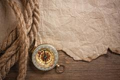 Stock Photo of compass, old paper and rope