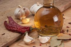 bottle with marinade and spices - stock photo