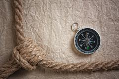 compass, old paper and rope, still-life - stock photo
