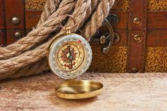 compass rope and a chest - stock photo