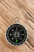 compass on wooden background - stock photo