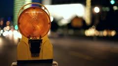 Construction light flashing on city street Stock Footage