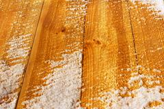 wooden shield covered with snow - stock photo
