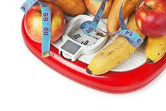 fruit on the floor scales - stock photo