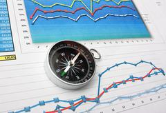 compass and paper work - stock photo