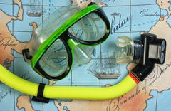 Mask and snorkel diving on map Stock Photos