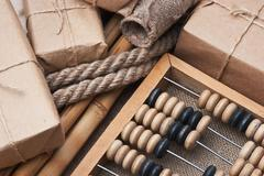 Pile parcel  and abacus Stock Photos