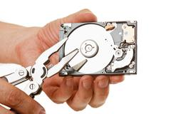 Open hard drive in hand Stock Photos