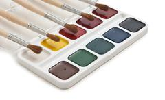 watercolor paints and  brushes - stock photo