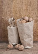 walnuts in a kraft paper bag - stock photo