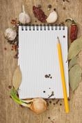 Stock Photo of notebook for recipes and spices