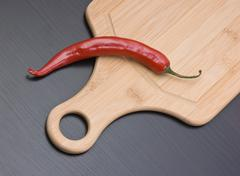 Red pepper on cutting board Stock Photos
