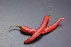 red chili pepper on the kitchen table - stock photo