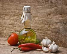 glass bottle with spices and vegetables - stock photo