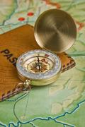 compass and passport on the map - stock photo