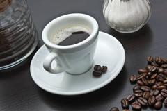 pile of coffee beans and a cup - stock photo