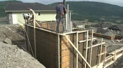 Industry, cement pump unit, pumping into foundation walls, wide shot Stock Footage
