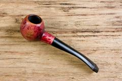 tobacco pipe old - stock photo