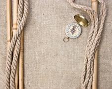 compass with ropes and bamboo on  canvas - stock photo