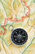 Stock Photo of compass on a map