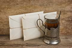 two letters and a glass of tea - stock photo