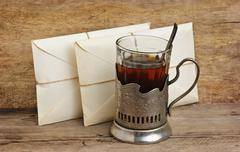 Stock Photo of two letters and a glass of tea