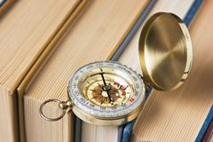 Compass and old books Stock Photos