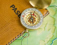 Compass and passport on the map Stock Photos