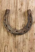 old rusty horseshoe - stock photo