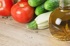 Stock Photo of vegetables and a bottle of oil, still life