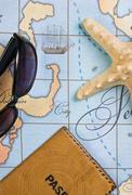 passport and sunglasses on map - stock photo